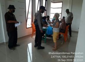 Polsek Panipahan Distribusikan BST Pada Masyarakat