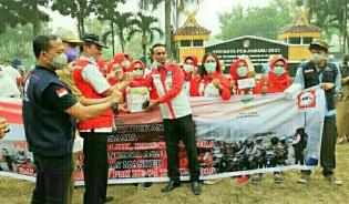 DPD LIRA Pekanbaru Bagikan Ribuan Masker Bersama PMI Pekanbaru
