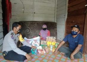 Polsek Simpang Kanan Salurkan Bantuan Kemanusiaan Korban Kebakaran Rumah