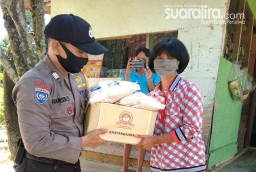 Sambut HUT Bhayangkara, Ranson Siburian Bagikan Sembako